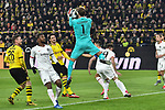14.02.2020, Signal Iduna Park, Dortmund, GER, 1. BL, Borussia Dortmund vs Eintracht Frankfurt, DFL regulations prohibit any use of photographs as image sequences and/or quasi-video<br /> <br /> im Bild / picture shows / Kevin Trapp (#1, Eintracht Frankfurt) pariert den Ball vor den herannahenden Lukasz Piszczek (#26, Borussia Dortmund) Mats Hummels (#15, Borussia Dortmund) <br /> <br /> Foto © nordphoto/Mauelshagen