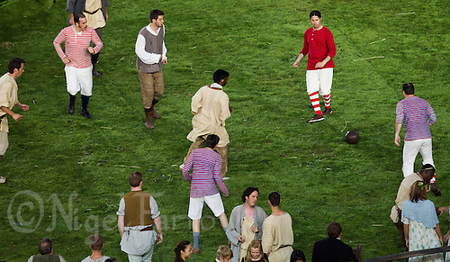 """27 JUL 2012 - LONDON, GBR - Actors play football during the """"Green and Pleasant Land"""" section of the Opening Ceremony of the London 2012 Olympic Games in the Olympic Stadium in the Olympic Park, Stratford, London, Great Britain (PHOTO (C) 2012 NIGEL FARROW)"""