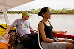 Jaguar (Panthera onca) biologists, Stephanny Arroyo-Arce and Ian Thomson, on boat in canal, Coastal Jaguar Conservation Project, Tortuguero National Park, Costa Rica