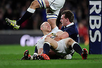 Mike Brown of England sees the funny side with Stuart Hogg of Scotland after scoring a try, which was later disallowed