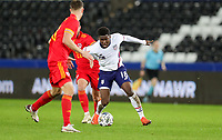 SWANSEA, WALES - NOVEMBER 12: Yunus Musah #18 of the United States  with the ball from Josh Sheehan #21 of Wales during a game between Wales and USMNT at Liberty Stadium on November 12, 2020 in Swansea, Wales.