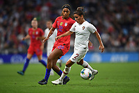 Saint Paul, MN - SEPTEMBER 03: Mónica Mendes #2 of Portugal and Jessica McDonald #22 of the United States during their 2019 Victory Tour match versus Portugal at Allianz Field, on September 03, 2019 in Saint Paul, Minnesota.