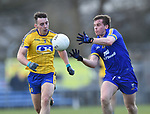 Sean Collins of Clare in action against John Mc Manus of Roscommon during their National League game at Cusack Park. Photograph by John Kelly.