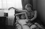 Couple Earls Court bedsit London UK 1977 Couple living in Earls Court London flat. Army deserter on the run. 1977