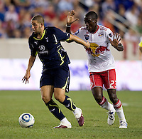 Adel Taarabt (11) of Tottenham pulls away from Tony Tchani (23) of the New York Red Bulls during the Barclays New York Challenge at Red Bull Arena in Harrison, NY.  Tottenham defeated the New York Red Bulls, 2-1.