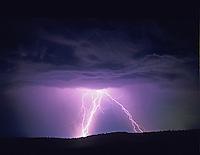 Lightning strikes over farmland. Near Alpine, Oregon