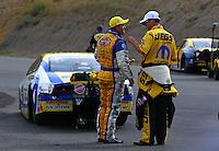 Jul. 20, 2014; Morrison, CO, USA; NHRA pro stock driver Allen Johnson (left) is congratulated by Jeg Coughlin Jr after winning the Mile High Nationals at Bandimere Speedway. Mandatory Credit: Mark J. Rebilas-