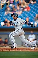 West Michigan Whitecaps third baseman Isaac Paredes (11) follows through on a swing during the first game of a doubleheader against the Lake County Captains on August 6, 2017 at Classic Park in Eastlake, Ohio.  Lake County defeated West Michigan 4-0.  (Mike Janes/Four Seam Images)
