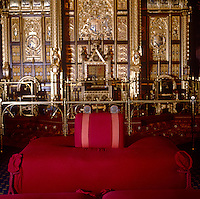 The woolsack, upon which the Lord Chancellor sits when he is present in the Chamber, originally symbolized the supremacy of England's trade in wool