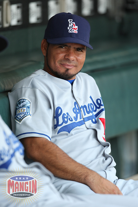 SAN FRANCISCO - JULY 6:  Luis Maza of the Los Angeles Dodgers gets ready in the dugout before the game against the San Francisco Giants at AT&T Park in San Francisco, California on July 6, 2008.  The Dodgers defeated the Giants 5-3.  Photo by Brad Mangin