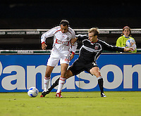 Chicago Fire midfielder Cuauhtemoc Blanco (10) tries to keeps possession of the ball while covered by DC United defender Bryan Namoff (26). DC United tied The Chicago Fire 0-0, at RFK Stadium in Washington DC, on Saturday October 13, 2007.