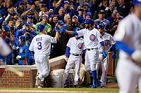 Chicago Cubs David Ross (3) high fives Dexter Fowler after an RBI sac fly in the fourth inning during Game 5 of the Major League Baseball World Series against the Cleveland Indians on October 30, 2016 at Wrigley Field in Chicago, Illinois.  (Mike Janes/Four Seam Images)