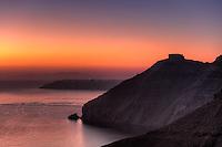 The famous skaros at sunset in Santorini, Greece