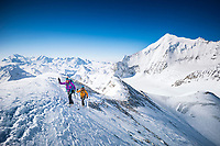 Ski tourers climbing the Brunegghorn, 3833 meters, while ski touring in the Swiss Alps