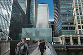 Workers in the Canary Wharf Docklands financial centre on the Isle of Dogs London.  Canary Wharf group is part-owned by the Qatari Sovereign Wealth Fund.