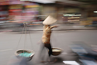 Hanoi<br /> , Vietnam - 2007 File Photo -<br /> <br /> A woman carrying  baskets of goods walk in a street of hanoi, in an artistic motion blur effect.<br /> <br /> <br /> <br /> photo : James Wong-  Images Distribution