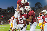 STANFORD, CA - SEPTEMBER 15, 2012: Stepfan Taylor celebrates his touchdown against USC at Stanford Stadium to open the PAC-12 regular season competition.  Stanford defeated the Trojans 21-14.