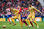 Angel Correa (C) of Atletico de Madrid competes for the ball with Borja Garcia Freire (L) and Alex Granell Nogue of Girona FC during the La Liga 2017-18 match between Atletico de Madrid and Girona FC at Wanda Metropolitano on 20 January 2018 in Madrid, Spain. Photo by Diego Gonzalez / Power Sport Images