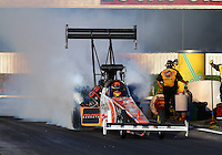 Nov 7, 2013; Pomona, CA, USA; NHRA top fuel dragster driver Clay Millican during qualifying for the Auto Club Finals at Auto Club Raceway at Pomona. Mandatory Credit: Mark J. Rebilas-