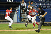 Batavia Muckdogs second baseman Mason Davis (7) gets splashed by water from Iramis Olivencia (49) as Rodrigo Vigil (27) runs from the bullpen after hitting a walk off home run as umpire Christopher Stump looks on during the second game of a doubleheader against the Williamsport Crosscutters on July 29, 2014 at Dwyer Stadium in Batavia, New York.  Batavia defeated Williamsport 1-0.  (Mike Janes/Four Seam Images)