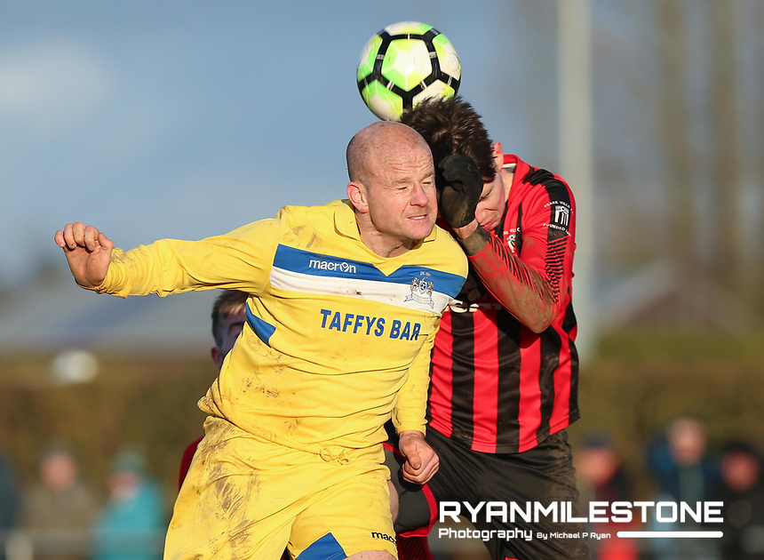 Paul Kirwan of Thurles in action against Michael Nally of Peake Villa during the Munster Junior Cup 5th Round at Tower Grounds, Thurles, Co Tipperary on Sunday 11th February 2018, Photo By Michael P Ryan