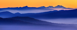 The glowing mist in the predawn hour over the distant Cascade range in Oregon.