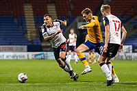 Bolton Wanderers' Antoni Sarcevic (left) competing with Mansfield Town's George Maris<br /> <br /> Photographer Andrew Kearns/CameraSport<br /> <br /> The EFL Sky Bet League Two - Bolton Wanderers v Mansfield Town - Tuesday 3rd November 2020 - University of Bolton Stadium - Bolton<br /> <br /> World Copyright © 2020 CameraSport. All rights reserved. 43 Linden Ave. Countesthorpe. Leicester. England. LE8 5PG - Tel: +44 (0) 116 277 4147 - admin@camerasport.com - www.camerasport.com