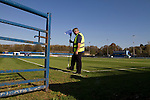 Lancaster City 0 FC Halifax Town 3, 15/10/2011, Giant Axe, FA Cup Third Qualifying Round. A groundsman putting a corner flag into the ground at Lancaster City's Giant Axe ground prior to the club's FA Cup third qualifying round match against FC Halifax Town. The visitors, who play two leagues above their hosts in the English football pyramid, won the ties by three goals to nil, watched by a crowd of 646 spectators. Lancaster City were celebrating their centenary in 2011, although there was a dispute over the exact founding date over the club known as Dolly Blue. Photo by Colin McPherson.