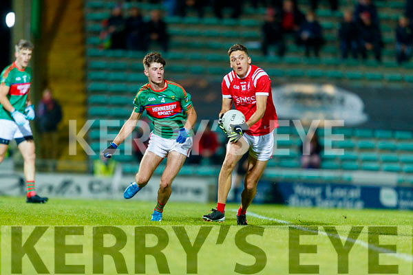 David Mangan, Mid Kerry in action against David Clifford, East Kerry during the Kerry County Senior Football Championship Final match between East Kerry and Mid Kerry at Austin Stack Park in Tralee on Saturday night.