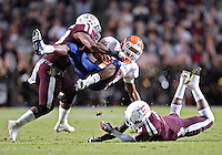 UTEP running back Aaron Jones #29 is tackled by Texas A&M linebacker Steven Jenkins #8 and defensive back Toney Hurd Jr. #4 during NCAA football game at Kyle Field in College Station, TX. Texas A&M defeats UTEP 57-7.during NCAA football game at Kyle Field in College Station, TX. Texas A&M defeats UTEP 57-7.