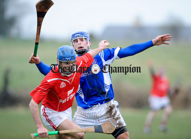 Crusheen's Gerry O Grady in action against Cratloe's Michael Hawes during their Clare Champion Cup second round game in Crusheen. Photograph by John Kelly.