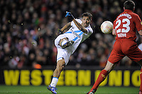 21.02.2013 Liverpool, England. Danny of Zenit St Petersburg with an athletic shot on goal during the Europa League game between Liverpool and Zenit St Petersburg from Anfield.