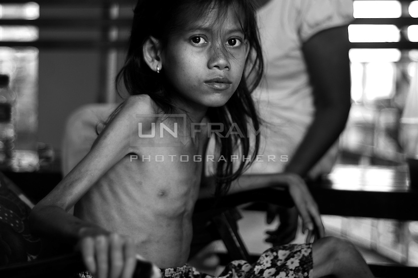 HIV-positive girl waiting in a reception ward. According to the recent data in Cambodia HIV rates are among highest in Asia.