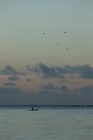 Man on Canoe at sunrise, Mclaren Harbour, Tufi, Cape Nelson, Oro Province, Papua New Guinea