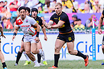 Sebastian Fromm of Germany (R) passes the ball during the HSBC World Rugby Sevens Series Qualifier Final match between Germany and Japan as part of the HSBC Hong Kong Sevens 2018 on 08 April 2018 in Hong Kong, Hong Kong. Photo by Marcio Rodrigo Machado / Power Sport Images