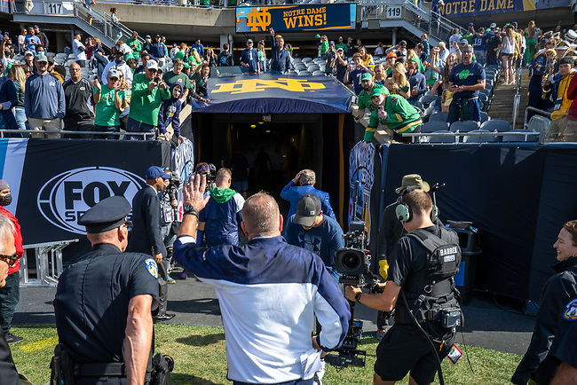September 25, 2021; Head football coach Brian Kelly runs to the locker room after the win against Wisconsin in the Shamrock Series game at Soldier Field in Chicago. (photo by Matt Cashore)