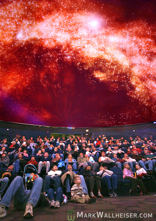 """Tallahassee families watch the free show """"Learning the Night Sky"""" at the Downtown Digital Dome Theater and Planetarium at the Challenger Learning Center January 5, 2008.    (Mark Wallheiser/TallahasseeStock.com)"""