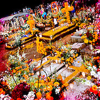 Graves covered by marigold flowers, gifts and candles, in honor of the deceased, are seen during the ritual celebration of the Day of the Dead (Día de Muertos) at the cemetery of Tzintzuntzan, Michoacán, Mexico, 1 November 2014.