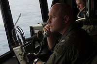 130511-N-DR144-285 PACIFIC OCEAN (May 11, 2013)- Lt. Evan Young controls the approach of a CH-46 Sea Knight from the helicopter control tower aboard San Antonio-class amphibious transport dock ship USS Anchorage (LPD 23).  Anchorage is underway after being commissioned in its namesake city of Anchorage, Alaska. (U.S. Navy photo by Mass Communication Specialist 1st Class James R. Evans / RELEASED)