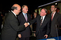 June 6 , 2002, Montreal, Quebec, Canada<br /> Frank Zampino, Montreal City Executive Commitee (L) <br /> Gerald Tremblay, Montreal (new) Mayor (M-L)<br /> Bernard Landry, Quebec Premier (M-R), <br /> Andre Boisclair, Quebec Minister Municipal Affairs, Quebec Minister Environment<br /> shake hands after signing a partnership agreement between the Quebec Gouvernment and the <br /> new City of Montreal (after all cities on the Montreal islanf merged with Montreal City), <br /> at the closing of the Montreal Summit (Le Sommet de Montr»al), June 6, 2002<br />  <br /> Mandatory Credit: Photo by Pierre Roussel- Images Distribution. (©) Copyright 2002 by Pierre Roussel <br /> ON SPEC<br /> NOTE l Nikon D-1 jpeg opened with Qimage icc profile, saved in Adobe 1998 RGB.
