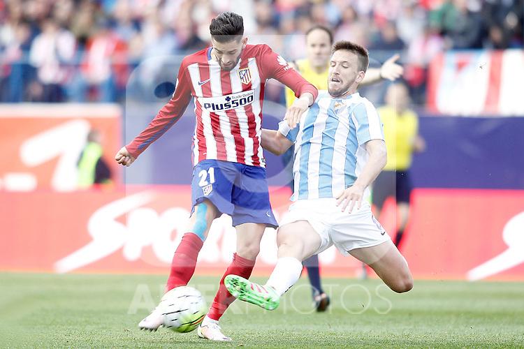 Atletico de Madrid's Yannick Carrasco (l) and Malaga CF's Ignacio Camacho during La Liga match. April 23,2016. (ALTERPHOTOS/Acero)