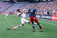 FOXBOROUGH, MA - JULY 25: Mason Toye #13 of CF Montreal tries to block the ball as Andrew Farrell #2 of New England Revolution clears it during a game between CF Montreal and New England Revolution at Gillette Stadium on July 25, 2021 in Foxborough, Massachusetts.