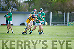 Ballyduffs Dylan Moriarty under pressure from Jedd Maunsell of Abbeydorney in the Minor Hurling Championship semi final.