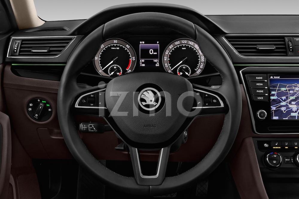 Car pictures of steering wheel view of a 2016 Skoda Superb Combi Laurin & Klement 5 Door Wagon Steering Wheel