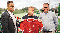 BNPS.co.uk (01202) 558833. <br /> Pic: DanPitmanPhotography/BNPS<br /> <br /> Pictured: Guy poses with a club shirt. <br /> <br /> Hollywood director Guy Ritchie was the unlikely guest of honour at the opening of a community football pitch in a small market town.<br /> <br /> The Lock, Stock and Two Smoking Barrels director signed autographs and chatted with parents and children at the unveiling of the £500,000 artificial pitch in Shaftesbury, Dorset.<br /> <br /> The local team, Shaftesbury FC, are stocking his 'Gritchie' beer made at his brewery in Ashmore, five miles away.