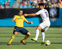 CHARLOTTE, NC - JULY 20: Nacho Monreal #18 and Riccardo Sottil #11 go after the ball during a game between ACF Fiorentina and Arsenal at Bank of America Stadium on July 20, 2019 in Charlotte, North Carolina.