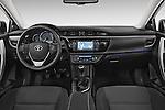 Stock photo of straight dashboard view of a 2014 Toyota Corolla Comfort 4 Door Sedan 2WD Dashboard