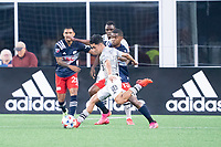 FOXBOROUGH, MA - JULY 25: Joaquín Torres #18 of CF Montreal takes a shot on the New England Revolution goal during a game between CF Montreal and New England Revolution at Gillette Stadium on July 25, 2021 in Foxborough, Massachusetts.