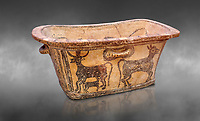 Minoan  pottery bath tub  larnax decorated with a cow nursing a calf,  Episkopi-Lerapetra 1350-1250 BC, Heraklion Archaeological  Museum, grey background.<br /> <br /> To the Greeks, the Underworld was entered by water. As with many other Minoan bathtubs, this one was probably later used as a coffin to convey the deceased across the sea, where marine imagery would be equally appropriate. The two functions of bathtubs, bathing and burial, combine in the story of Agamemnon who, on return from Troy, was murdered by his wife and her lover in a silver bath.