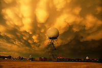 WSR-88D Doppler weather radar shown with dramatic display of golden mammatus clouds after an episode of severe thunderstorms in the Norman, Oklahoma.